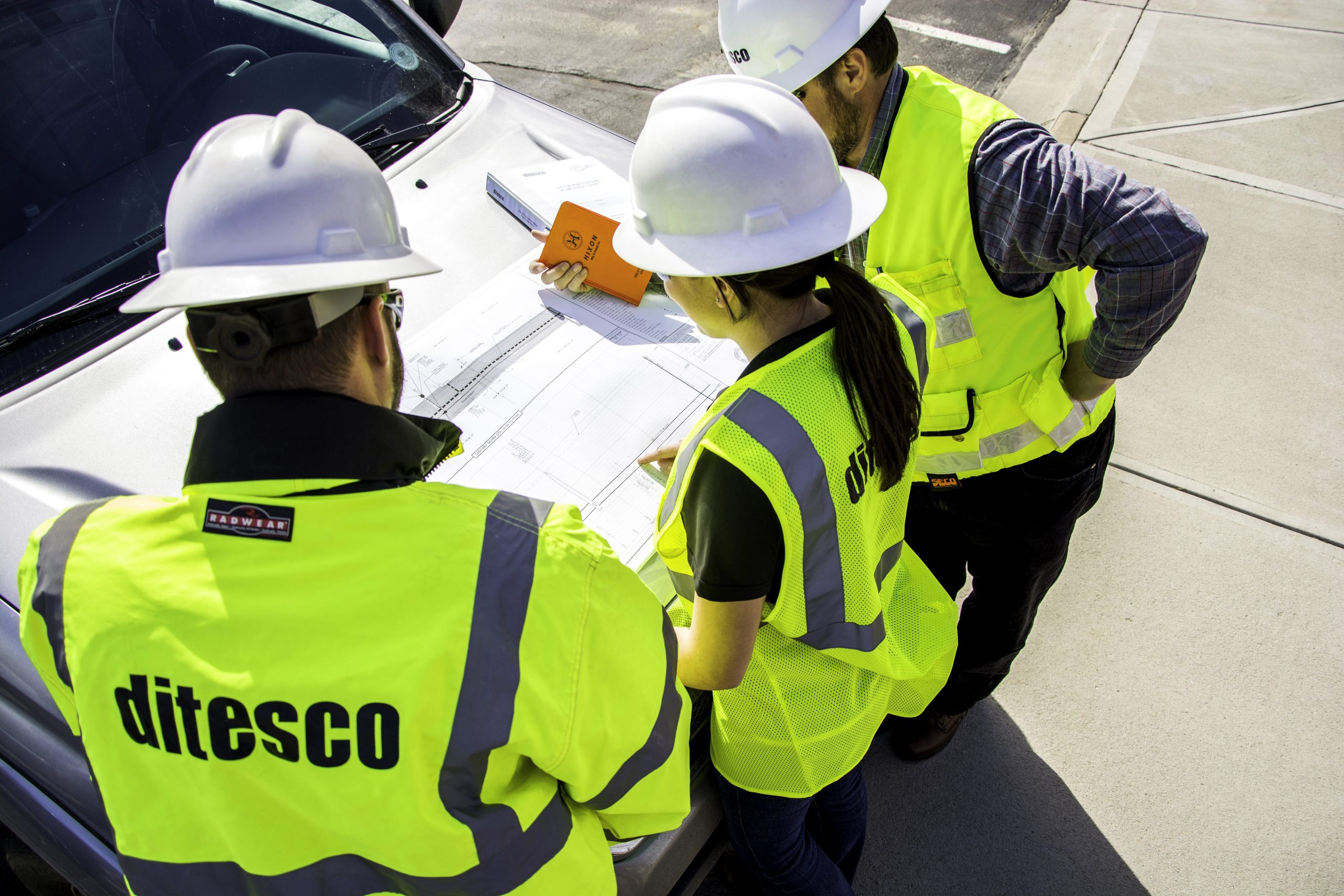 Image of ditesco construction workers inspecting blue prints